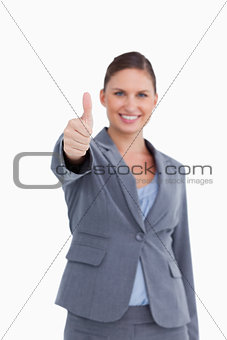 Thumb up given by smiling saleswoman