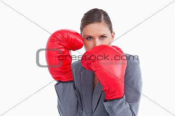 Tradeswoman with boxing gloves in defensive position
