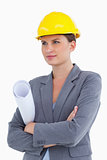 Female architect with plans and helmet on