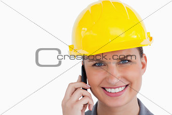 Close up of smiling female architect on her cellphone