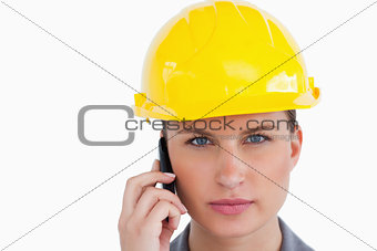 Close up of serious female architect on her cellphone
