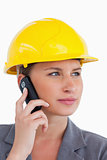 Close up of female architect on her cellphone with helmet on