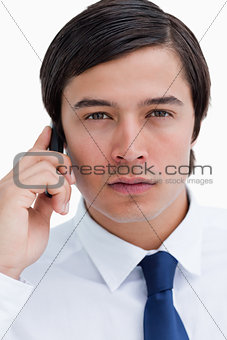 Close up of serious tradesman on his cellphone