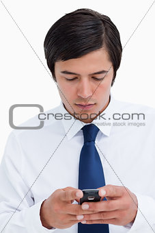 Close up of tradesman reading text message