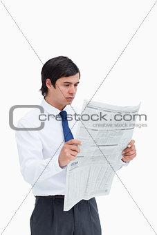 Young tradesman reading the news