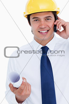 Close up of smiling male architect on his cellphone