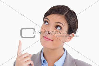 Close up of female entrepreneur pointing and looking up
