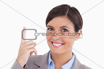 Close up of smiling female entrepreneur pointing up