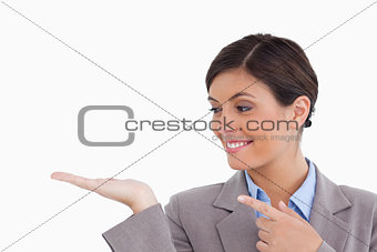 Close up of female entrepreneur looking and pointing at her palm