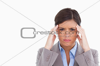 Close up of female entrepreneur having a headache