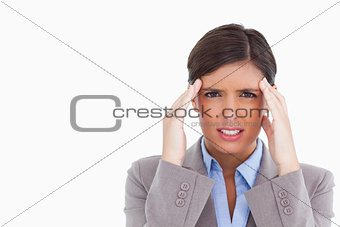 Close up of female entrepreneur experiencing a headache