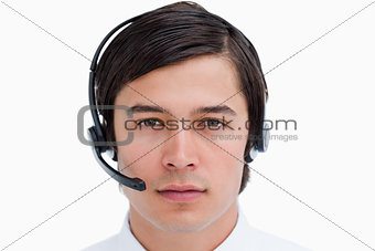 Close up of male call center agent with headset on