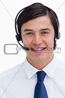 Close up of male telephone support employee with headset on