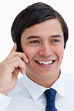 Close up of smiling tradesman on his cellphone