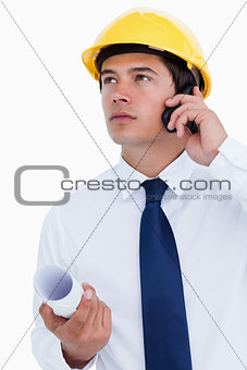 Close up of male architect listening to caller