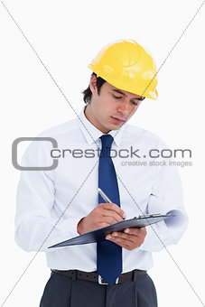 Close up of male architect taking notes