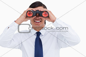 Close up of smiling tradesman looking through spy glass