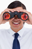 Close up of smiling tradesman looking through binoculars