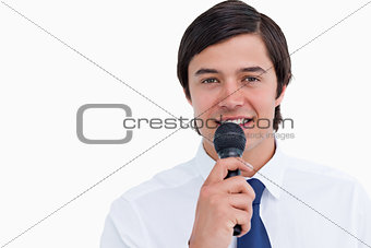 Close up of smiling tradesman with microphone