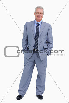 Smiling mature tradesman with his hands in his pockets