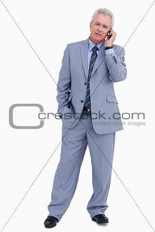 Mature tradesman on his cellphone
