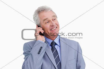 Close up of mature cheerful tradesman on his cellphone