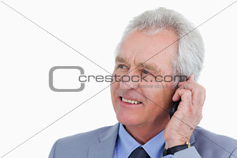Close up of mature tradesman talking on his mobile phone