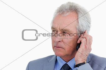 Close up of mature tradesman listening to caller