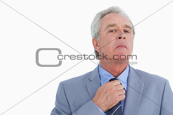 Close up of mature tradesman adjusting his tie