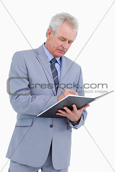 Mature tradesman taking notes