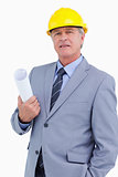 Confident mature architect with helmet and plans