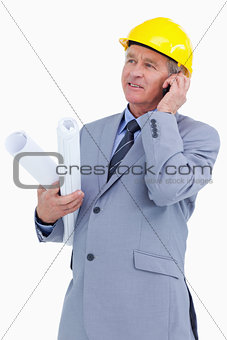 Mature architect on his cellphone