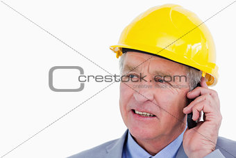 Close up of mature architect on the phone