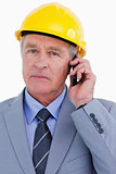 Close up of mature architect on his cellphone