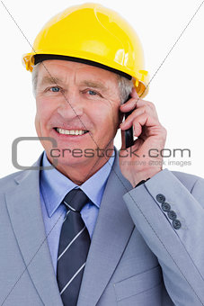 Close up of smiling mature architect on his cellphone