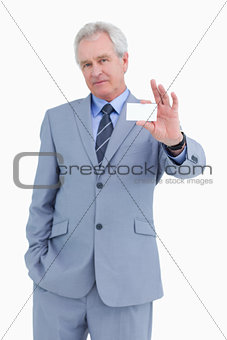 Mature tradesman presenting his business card