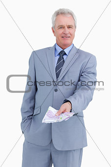 Mature tradesman with bank notes in his hand