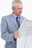 Mature tradesman reading the news paper