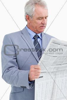 Mature tradesman reading the news paper