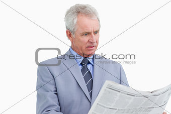 Mature tradesman surprised by the news paper