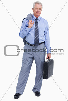 Mature tradesman with suitcase and jacket over his shoulder