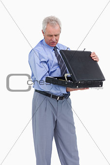 Mature tradesman taking a look into his suitcase