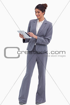 Smiling female entrepreneur working on her tablet computer