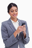 Smiling female entrepreneur writing text message