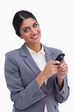 Smiling female entrepreneur with her cellphone