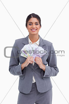 Smiling female entrepreneur with bank notes