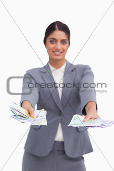 Female entrepreneur handing over money