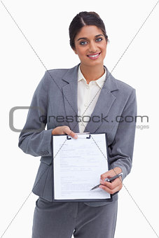 Smiling female entrepreneur asking for signature