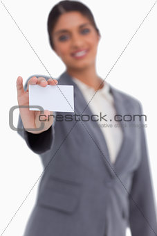 Blank business card being shown by female entrepreneur