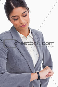 Close up of female entrepreneur looking at her watch